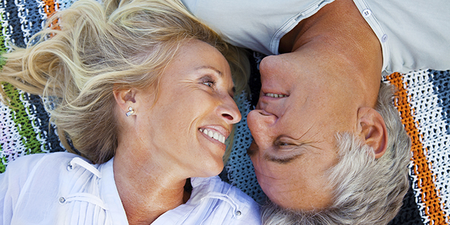 A-happy-senior-couple-lying-on-a-picnic-blanket_slider